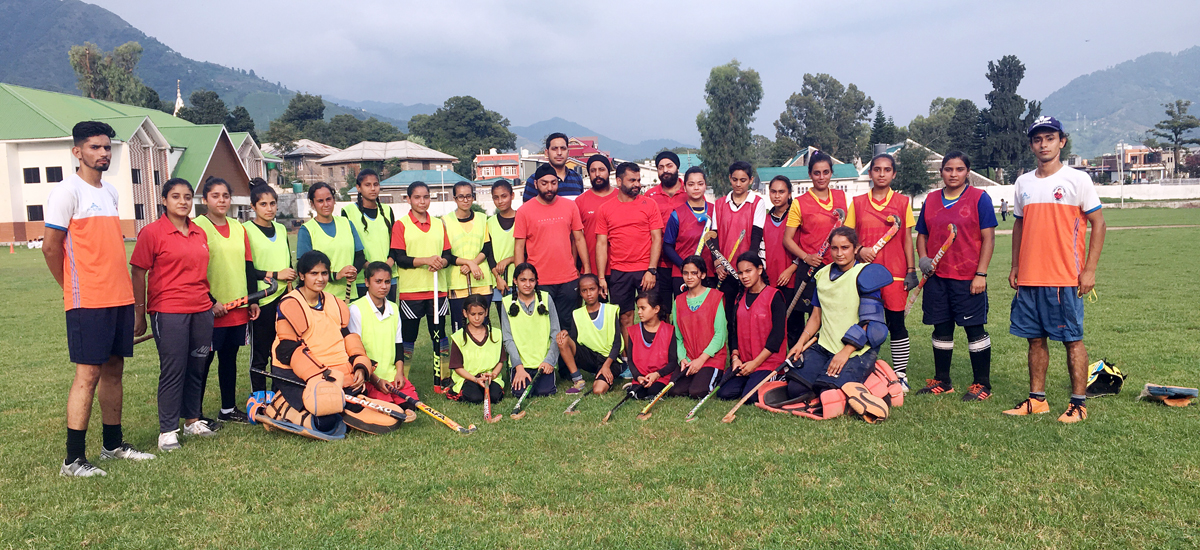 Players posing for a group photograph during an inaugural match at Poonch.