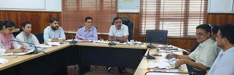 DC Jammu Ramesh Kumar chairing a meeting on Friday.