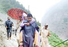 Commanding Officer, IRP 4th Battalion, Abrar Chowdhary shifting a sick yatri to safer place at Real-Pathri on Sunday.