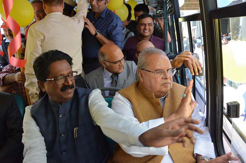 Governor and Union Minister taking short trip in electric bus in Srinagar.