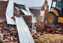 Illegal structures being demolished in Samba on Sunday.