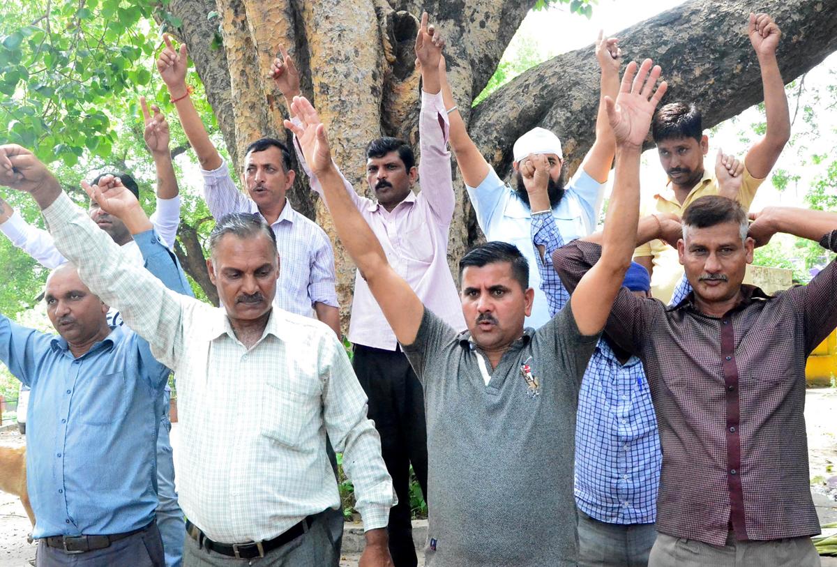 Porters of Kargil war during a protest demonstration at Jammu on Sunday. — Excelsior / Rakesh