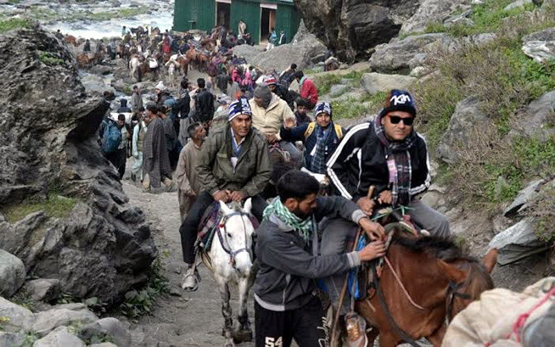 Shri Amarnath yatris heading towards cave shrine.— Excelsior/Sajjad Dar