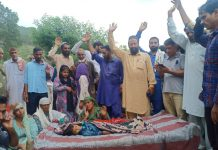 People protesting after death of two in road mishap.