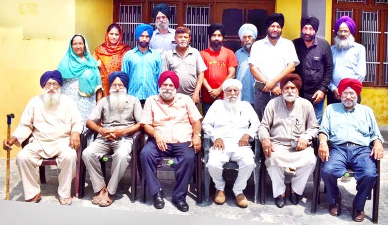 Poets and intellectuals during a monthly meeting of Punjabi Sahitik Sabha at Simbal Camp on Sunday.