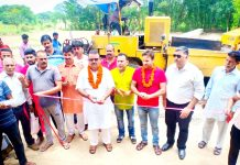 Former Minister, CP Ganga kick starting blacktopping of road in Vijaypur Assembly segment on Sunday.