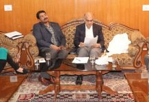Advisor K K Sharma chairing a meeting at Leh on Monday.