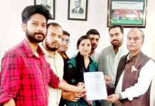 ABVP activists submitting a memorandum to JU Vice-Chancellor.