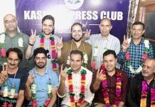 Winners of first-ever elections of Kashmir Press Club posing for photograph in Srinagar. -Excelsior/Shakeel
