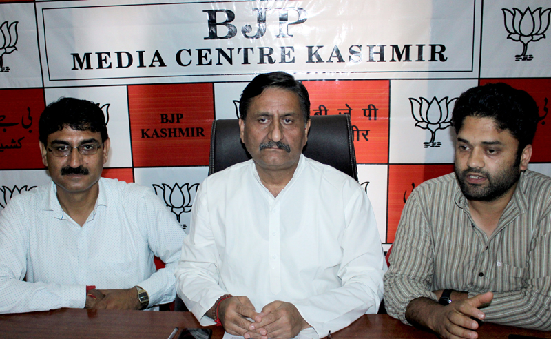 State spokesperson of BJP, Ashwani Kumar, addressing a press conference in Srinagar on Friday. -Excelsior/Shakeel