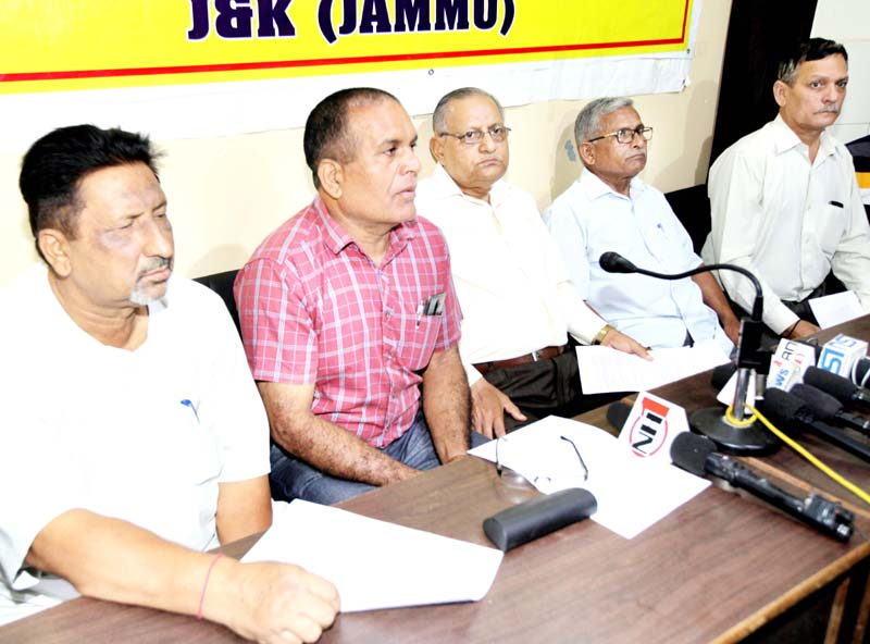 Members of Pradesh Vishwakarma Sabha during a press conference at Jammu on Sunday. -Excelsior/Rakesh