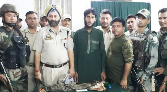 Arrested militant in custody of Army and police in Doda on Wednesday.