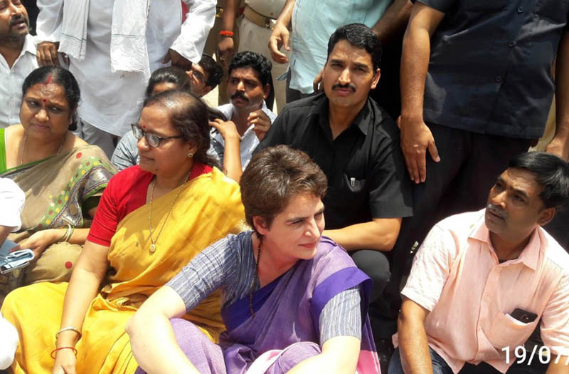 Congress General Secretary Priyanka Gandhi Vadra sitting on dharna after she was stopped from proceeding to Sonbhadra to meet the victims of clash that claimed ten lives in Mirzapur on Friday. (UNI)
