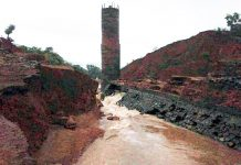 """MUMBAI, July 3: Twenty three persons are feared dead after a dam in Maharashtra's coastal Konkan region breached following incessant rains leading to flood-like situation in downstream villages, officials said Wednesday. Bodies of 11 persons have been recovered so far, a police official said. The total toll would be 23, he added. The Tiware dam in Chiplun taluka of Ratnagiri district has a storage capacity of 20 lakh cubic metre. It developed a breach late Tuesday night, a district official said. The dam breach caused a flood-like situation in seven downstream villages, with 12 houses being swept away. """"So far, 11 bodies have been recovered,"""" said Additional Superintendent of Police, Ratnagiri, Vishal Gaikwad. Police have moved villagers to safety, he added. Relatives of the victims said they had asked district administration to repair the dam as they had spotted cracks in November last year. There was an issue over the jurisdiction of which tehsil Tiware dam falls in, as Chiplun and Dapoli tehsil offices had ignored the application of the villagers, said a family member of one of the dead. """"It is only because of their negligence that we have seen this day,"""" he said. """"My parents, wife and child of one and a half year is missing,"""" he added. """"My brother, who had gone to bring his vehicle did not return,"""" he said. A search operation has been launched by the National Disaster Response Force (NDRF) and state police personnel. A police officer said rescue operations were hampered initially due to darkness and sudden influx of water. Local public representatives claimed the government neglected their pleas for repair of the dam. They said the administration was informed about cracks in the walls of the dam, but no action was taken. Maharashtra Water Resources Minister Girish Mahajan said villagers in the area had complained of cracks in the dam. """"This dam was built 14 years ago. The state government will find out at which level there was negligence and necessary action wil"""
