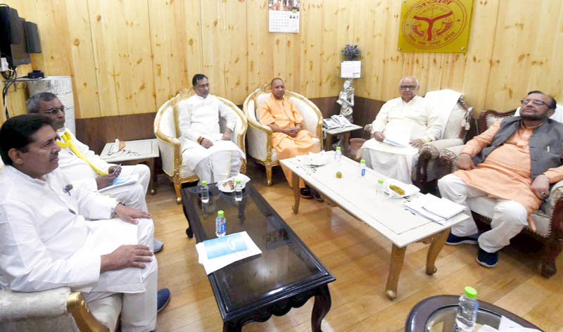 Uttar Pradesh Chief Minister Yogi Adityanath, Assembly speaker H N Dixit and others attend the all-party meeting ahead of the Monsoon Session of UP Assembly at Vidhan Bhawan in Lucknow Wednesday. (UNI)