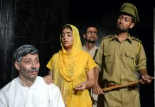 A scene from the play 'Jurm Aur Saza' staged at Jammu on Sunday.