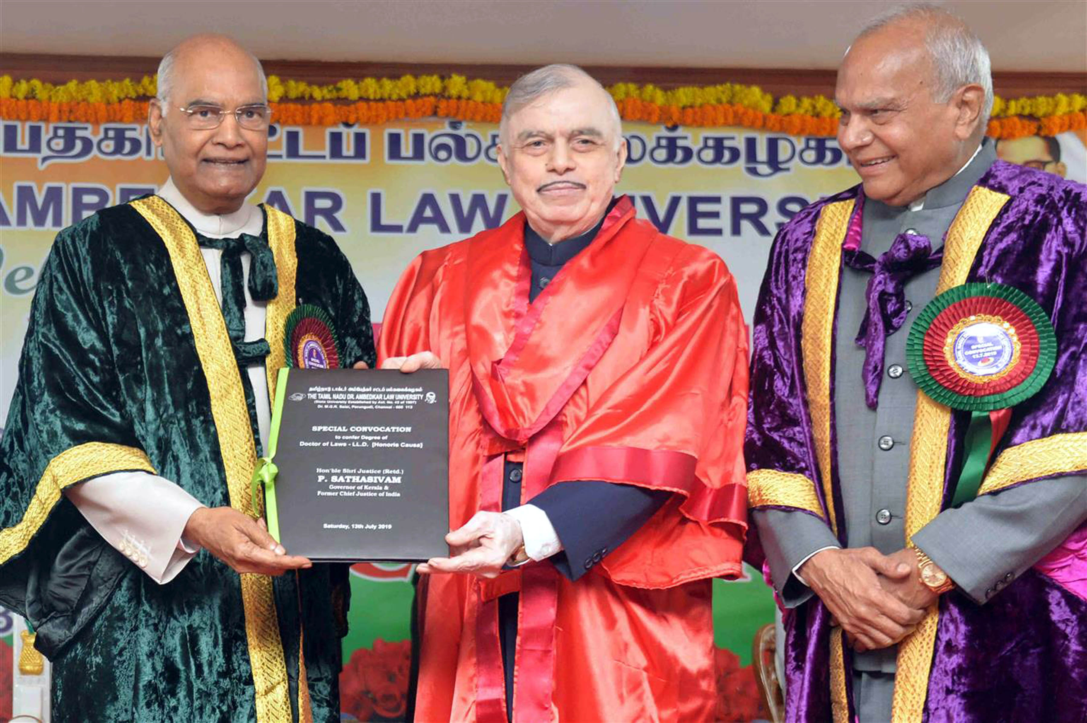 President Ram Nath Kovind conferring the L.L.D. (Honoris Causa) Degree to Kerala Governor and former Chief Justice of India, Justice (Retd) P Sathasivam at a special convocation ceremony of the Tamil Nadu Dr Ambedkar Law University, in Chennai on Saturday. (UNI)