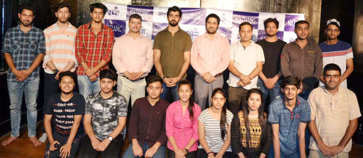 Participants of acting workshop organized by Natrang along with its Director, Balwant Thakur and trainer Vikram Sharma posing for a group photograph.