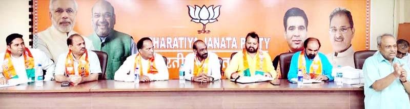 Senior BJP leaders at a meeting of party's SC Morcha at Trikuta Nagar in Jammu on Thursday.