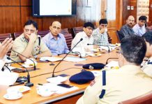 Advisor Vijay Kumar chairing a meeting on Monday.