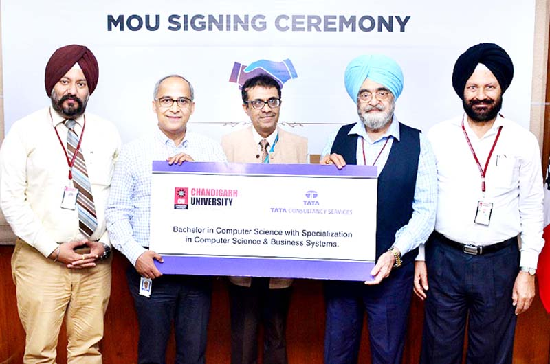 Vice-Chancellor of Chandigarh University and Global Vice-President, Human Resources TCS exchanging MoU documents.