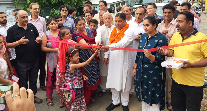 Former Minister, Sat Sharma dedicating transformer to residents of Green Enclave on Monday.