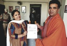 Rajni Rohmetra who was nominated as State Working Committee Member of BJP receiving letter from State president, Ravinder Raina at BJP Headquarters, Trikuta Nagar, Jammu on Monday.