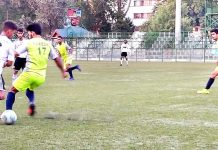 Footballers in action during a match of JKFA Annual League Football Tournament at TRC ground in Srinagar.