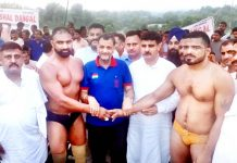 Wrestlers contesting for the title bout being introduced by the guests at Chak More in Udhampur.