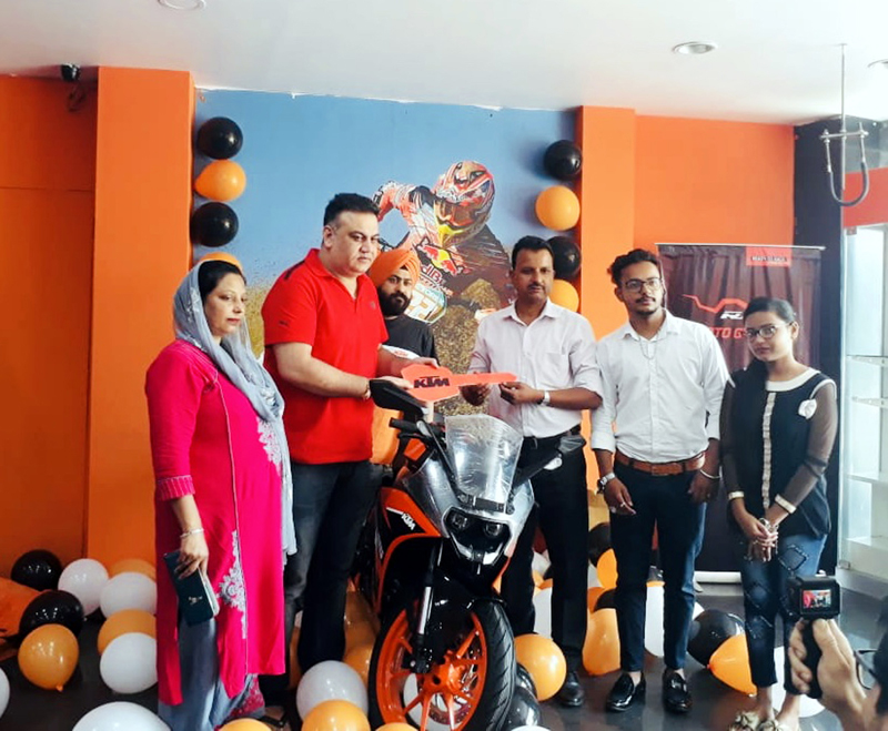 Officials of KTM handing over the keys of newly launched all-new RC 125 ABS to a customer at Jammu.