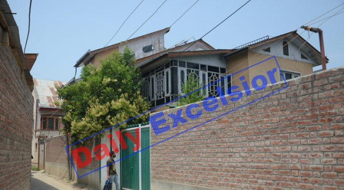 The residential house of separatist leader Syed Asiya Andrabi, at Soura area on Srinagar outskirts, which has been attached by the NIA. —Excelsior/Shakeel