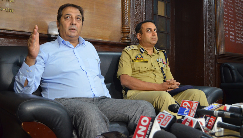 Divisional Commissioner Baseer Khan and IGP Kashmir S P Pani addressing press conference in Srinagar on Wednesday. —Excelsior/Shakeel