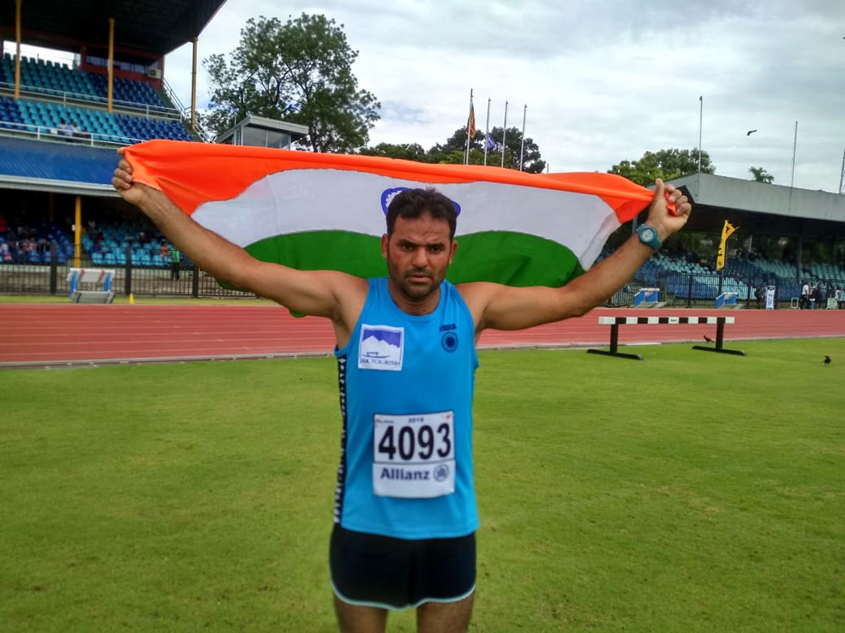 Reyaz Ahmed of JKP holding Indian flag after excelling in International Championship in Sri Lanka.