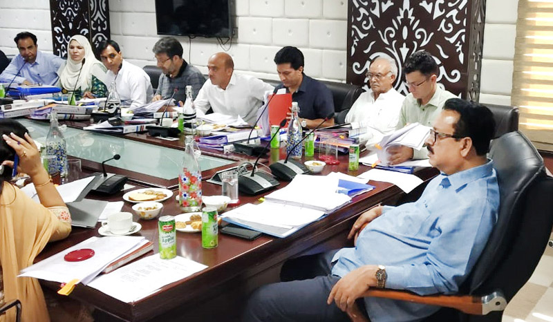 Principal Secretary Industries Navin Chaudhary chairing a meeting on Monday.