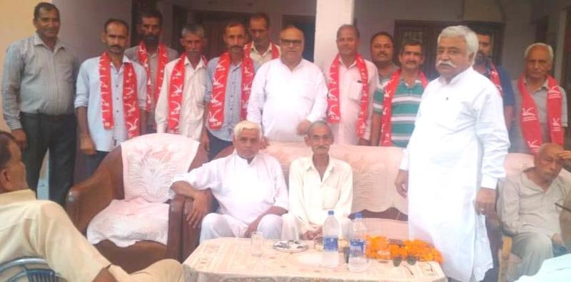 Senior NC leader Ajay Sadhotra addressing workers meeting in Mandal area of Marh on Monday.
