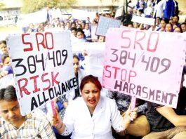 Paramedical employees engaged under SRO 384 and 409 sitting on hunger strike in GMC Jammu. -Exceslior/Rakesh