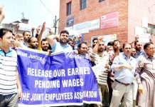 PHE employees protesting in Srinagar. -Excelsior/Shakeel