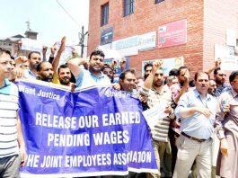PHE employees protesting in Srinagar. -Excelsior/Shakeel