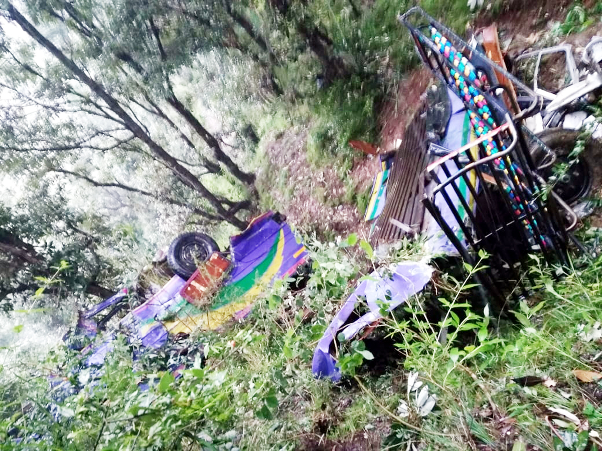 Wreckage of mini-bus lying in gorge in Thanamandi area on Sunday. —Excelsior/Gafoor Bhat