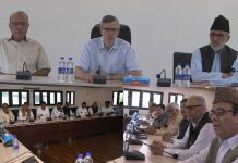 Omar Abdullah chairing NC Political Affairs Committee meeting at Srinagar on Sunday.