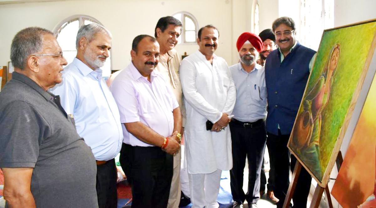 MLC Vikram Randhawa, State Executive Member Raman Suri and others during National Art Festival at Jammu.