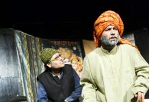 A scene from the play 'Hangama Ho Gaya' staged by Natrang at Jammu on Sunday.