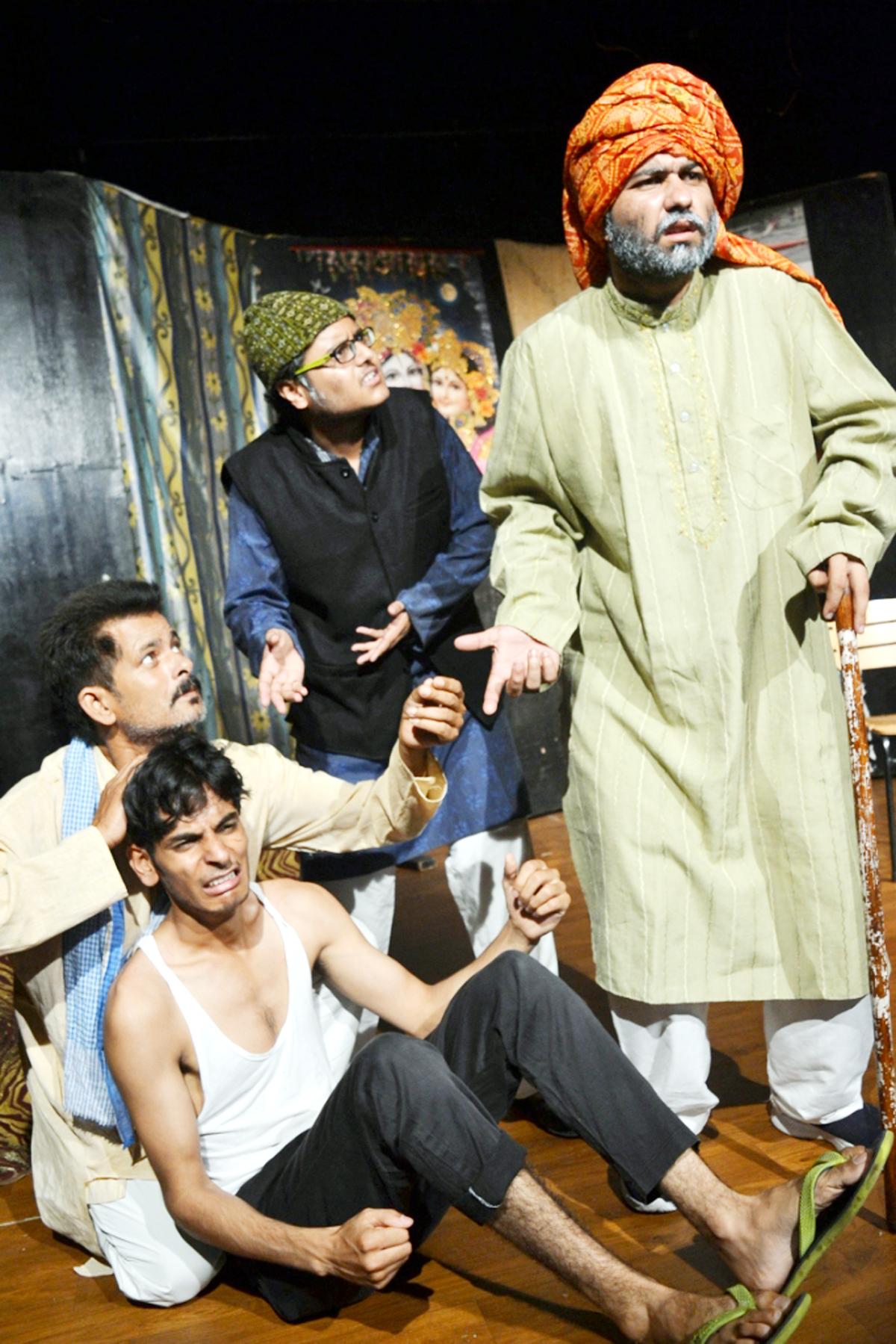 A scene from the play 'HangamaHoGaya' staged by Natrang at Jammu on Sunday.
