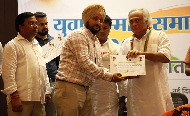 PYC leader Nimrandeep Singh being honoured by Cong MP Jai Ram Ramesh during a function at Delhi.