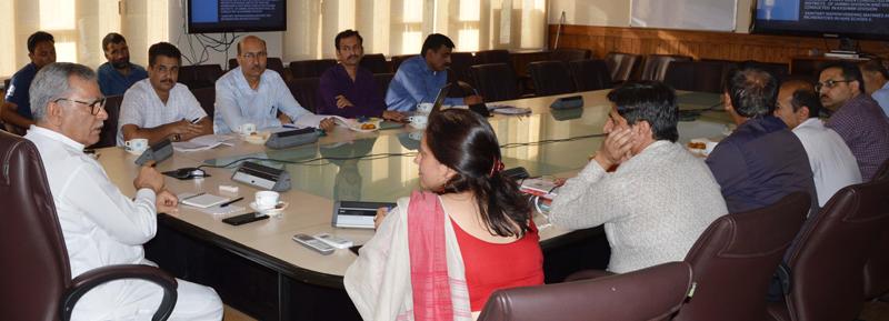 Advisor Farooq Khan chairing a meeting at Srinagar on Thursday.