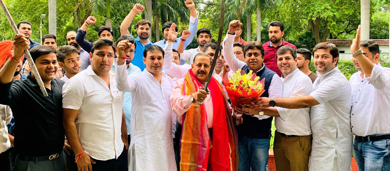 Bharatiya Janata Yuva Morcha (BJYM) Karyakartas, led by Delhi State BJYM President Sunil Yadav, felicitating Union Minister Dr Jitendra Singh and celebrating abrogation of Article 370, at New Delhi on Thursday.
