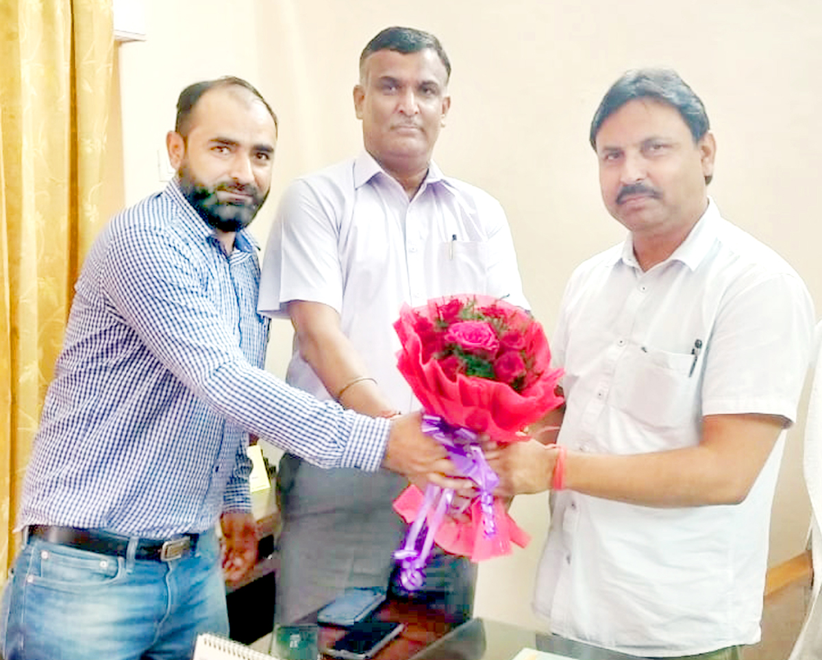 Officers felicitating Dr. Bharat Bhushan on joining as MD, SC, ST, OBC Development Corporation.