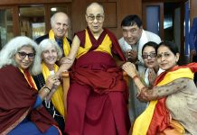 Kingian non-violence peace educators posing with Dalai Lama.