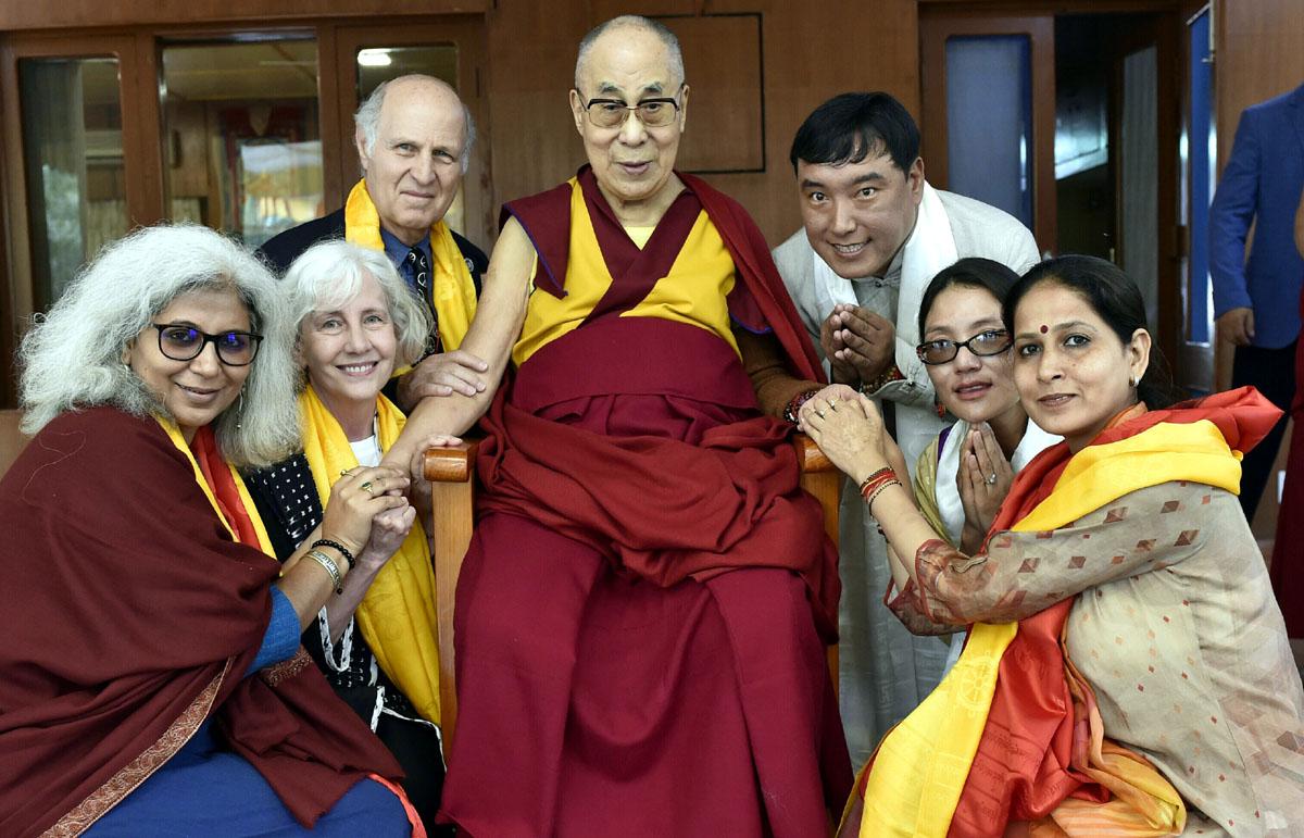 Kingian non-violence peace educators posing with Dalai Lama.