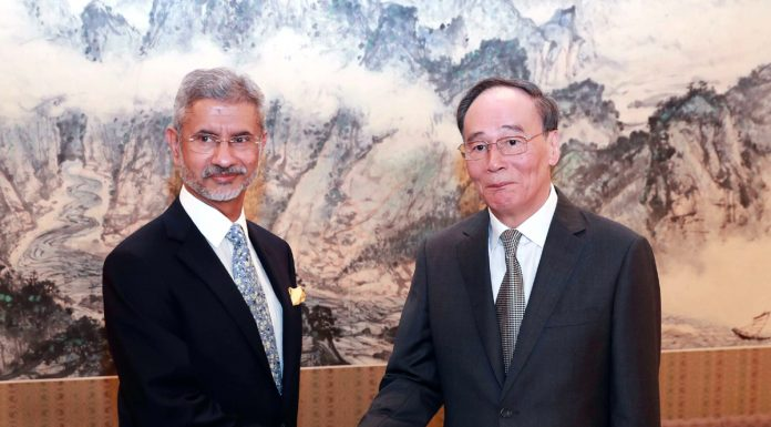 Chinese Vice President Wang Qishan meets with Minister of External Affairs Subrahmanyam Jaishankar in Beijing on Monday. (UNI)